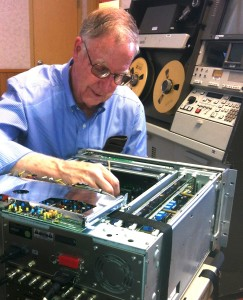"Ken Zin works on a 3/4"" Sony deck with an Ampex AVR-3 in the background"